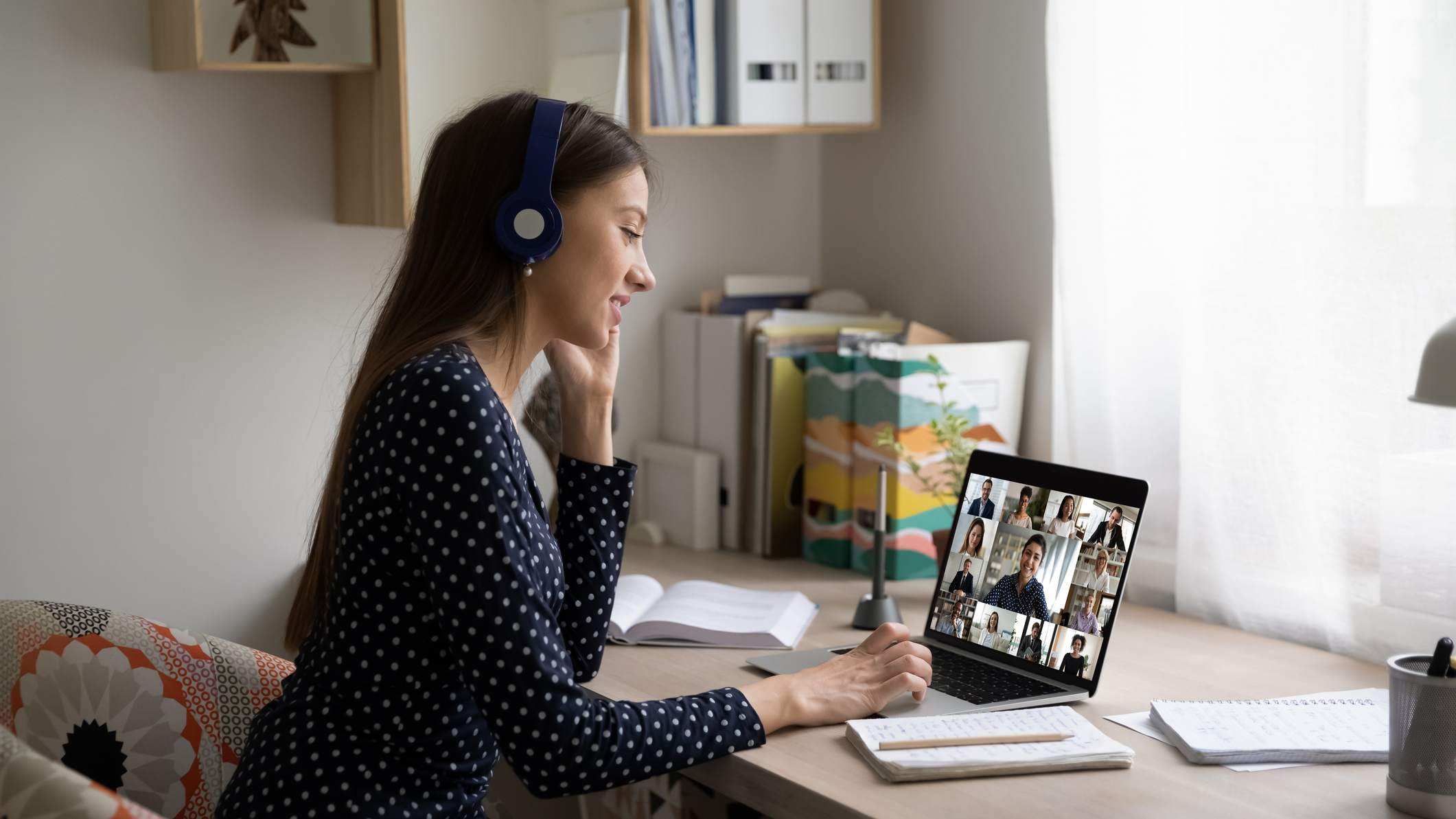 Woman conducting work meeting remotely