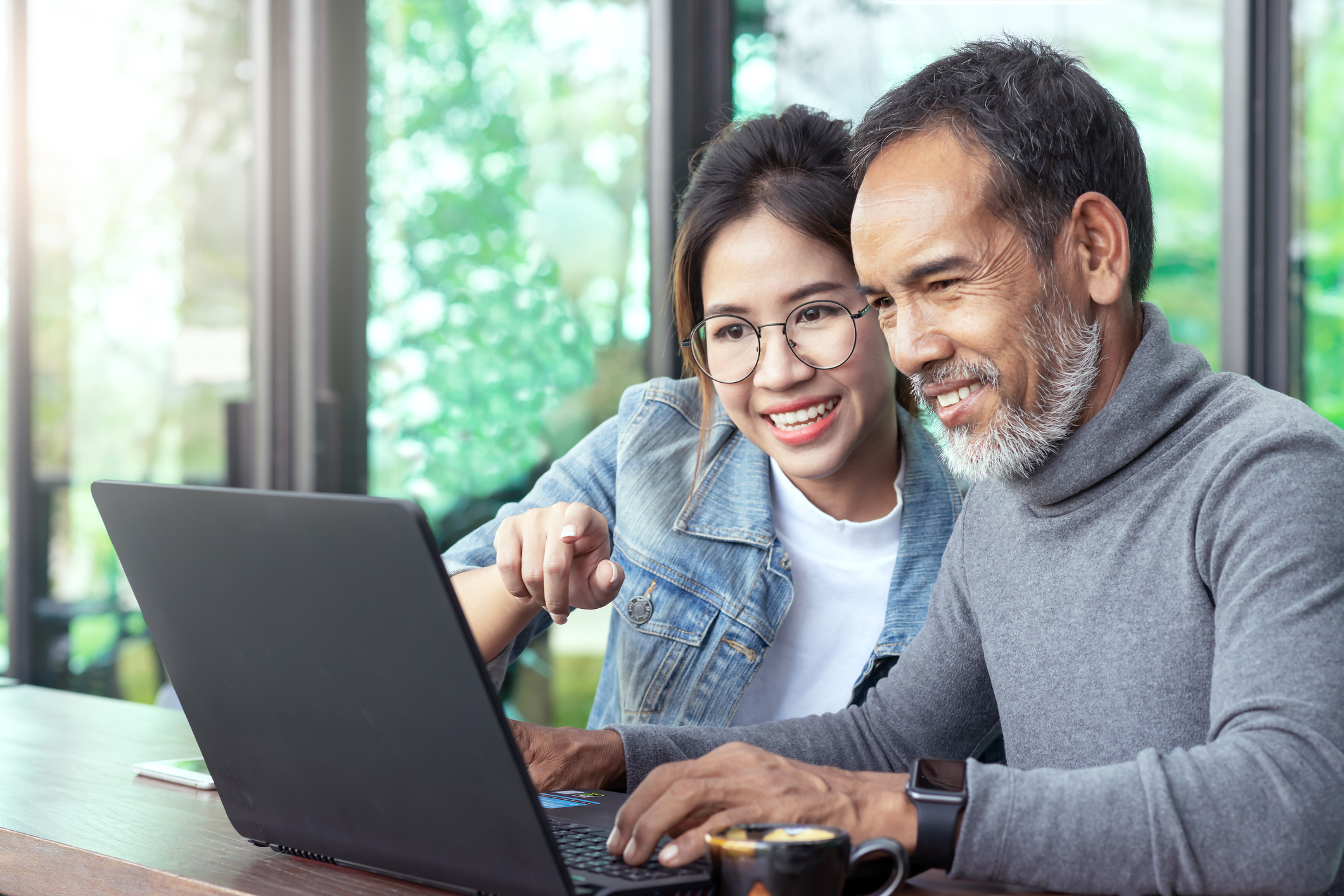 couple planning for retirement using their laptop