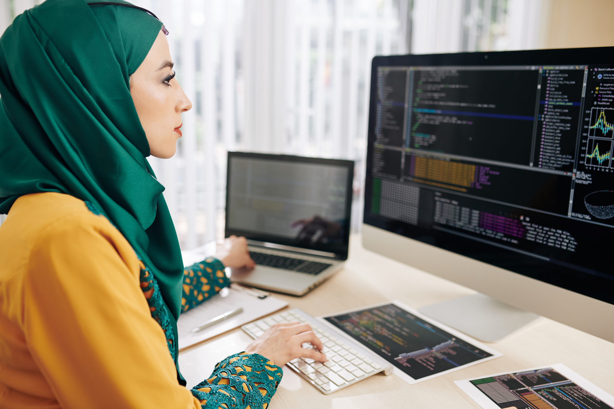 asset manager using two computers